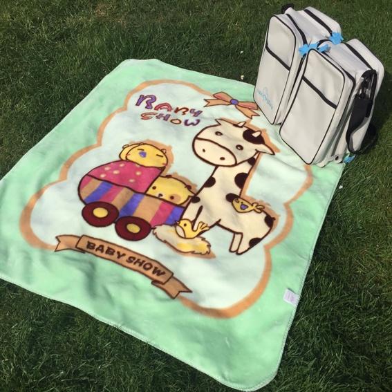 Handsignierte Wickeltasche + Babydecke